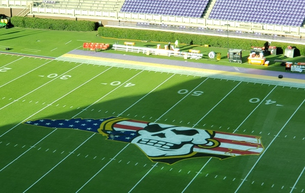 A red-white-blue Pirate logo inside Dowdy-Ficklen Stadium